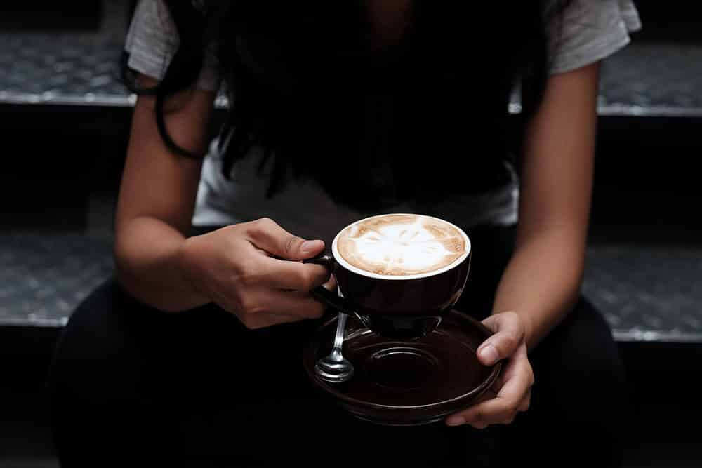Girl sitting with a latte