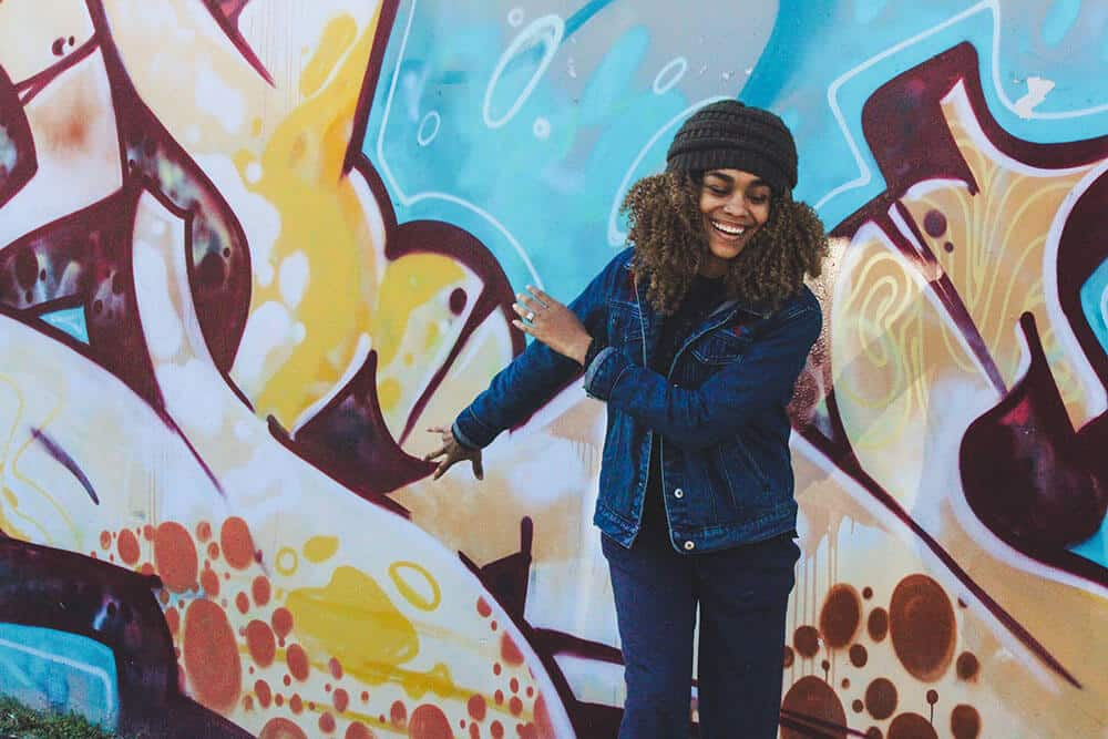 excited woman with graffiti