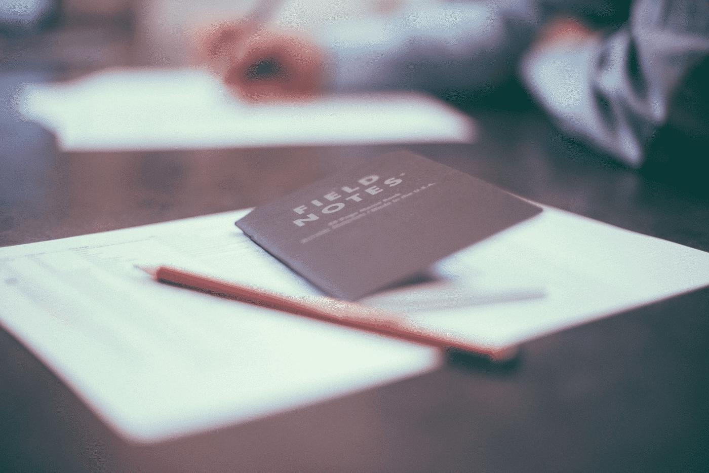 field notebook on desk