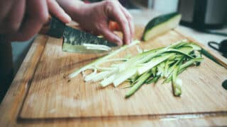 chopping cucumber into sticks