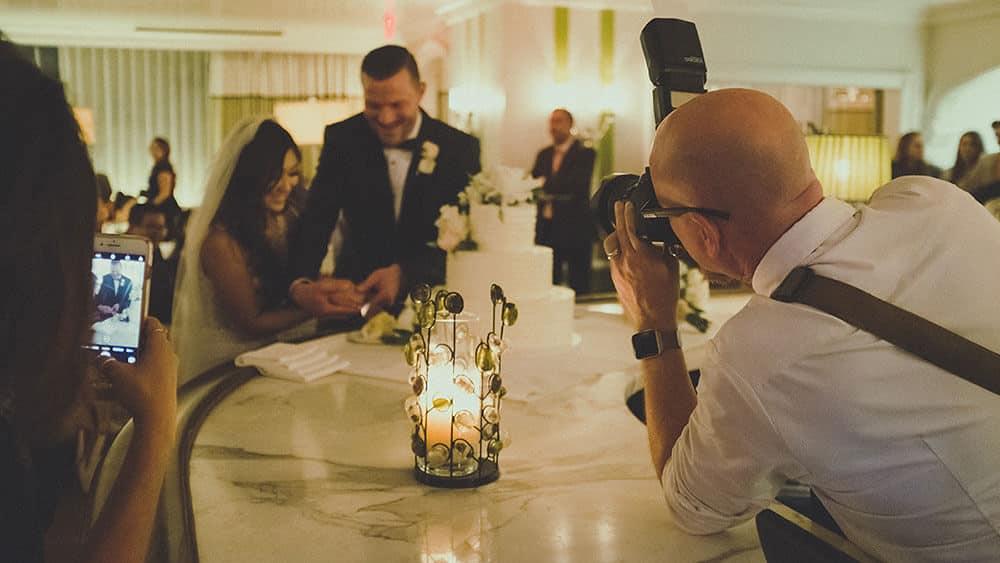 Wedding photographer photographing couple